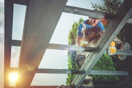 Pro Carpenter at Work. Wood Construction Job. Reklamní fotografie