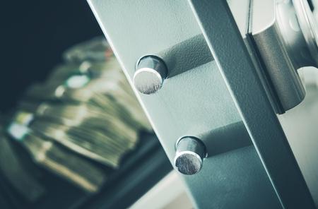 deposit: Money in the Residential Safe Box Closeup Photo. Cash Money Safe Deposit.