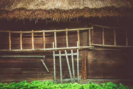 central european: Vintage Wooden House Closeup Photo. Central European Ancient Architecture. Old Wood Logs Home. Stock Photo