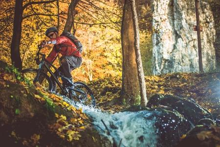 Scenic Forest Bike Trail. Fall Foliage Biking. Caucasian Men on the Bike Trip.