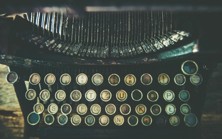 vintage document: Dirty Aged Typewriter Top View Photo.