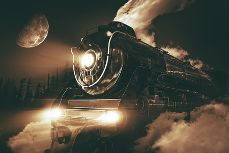 railway transportations: Speeding Steam Locomotive Crossing Rocky Mountains at Night.