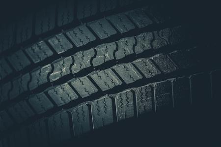 tread: Car Tire Tread Closeup Photo. Brand New Vehicle Tire