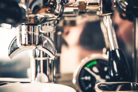 grinded: Stainless Steel Espresso Coffee Maker Closeup Photo.