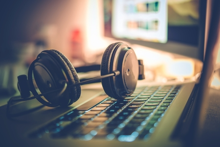 Digital Music Creation Theme with Professional Headphones on the Computer Keyboard. Archivio Fotografico