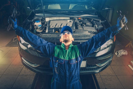 super car: Car Service Well Done. Car Fixing Triumphant. Super Satisfied Car Mechanic in His Small Garage Car Service. Mechanical Challenge Winner. Auto Service Worker. Stock Photo