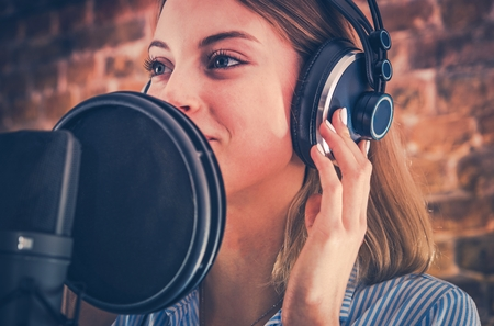 Woman Recording Audiobook. Audio Recording Studio Theme. Caucasian Voice Talent. Stock Photo
