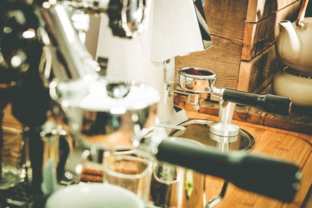 grinded: Coffee Making Equipment Closeup Photo. Elegant Shiny Coffee Maker and Grider Stock Photo