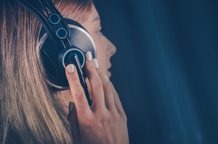 loudness: Girl Listening the Music on Her Headphones. Online Digital Music and Mobile Audio Devices Theme. Stock Photo