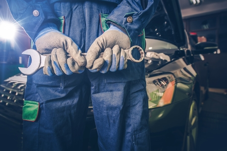 servicing: Car Mechanic Ready For Work. Auto Mechanic with Large Wrench in Hands.