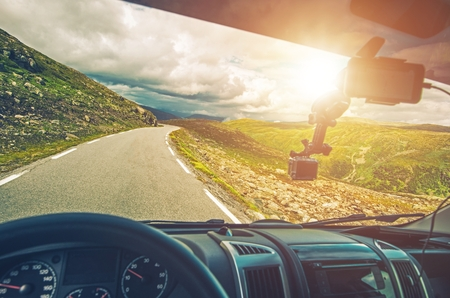 motorcoach: Scenic RV Road Trip. Driving Camper Van Through Mountain Landscape. RV Vacation. Stock Photo