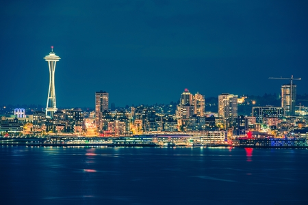 seattle skyline: Part of the Seattle Skyline in the State of Washington, United States. Seattle Skyline and the Bay During Night Hours. Stock Photo