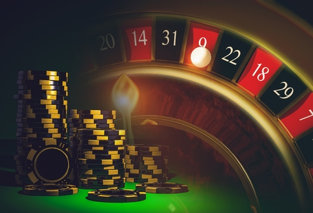 casinos: Roulette Casino Games Concept with Black and Yellow Casino Chips. Casino Game. Stock Photo