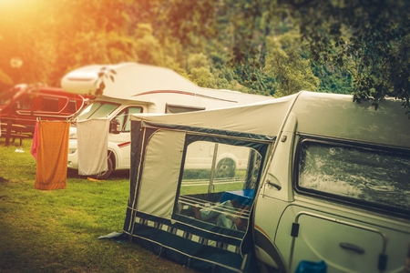 motorcoach: Summer RV Camper Camping. Relaxing on the Campground.  Stock Photo