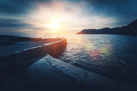 Mediterranean Sea Sunset. Vernazza in Province of La Spezia, Italy. Dark Blue Color Grading.
