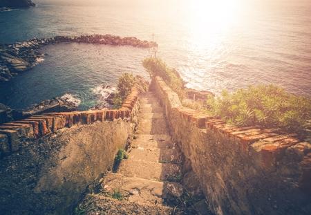 italian architecture: Stairs To The Sea. Italian Riviera Architecture. Riomaggiore.  Stock Photo