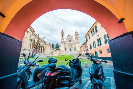 italian architecture: Basilica di Santo Stefano in Lavagna. City Street and Motorcycles. Italian Architecture.
