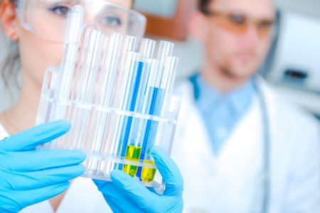 testing: Hospital Laboratory Research Team Concept Photo. Caucasian Laboratory Workers. Stock Photo