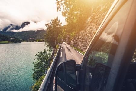 motorcoach: Driving Motohome Through Narrow Norwegian Road. Rving in the Norway.