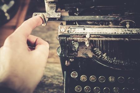 typewriting: Typewriting on the Rusty Vintage Typewriting Machine. Stock Photo