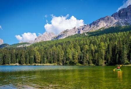 Scenic Kayak Touring on the Italian Alps Lake. Caucasian Outdoor Man in the Kayak.
