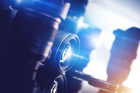 Photography and Photo Studio Equipment on the Glassy Rack. Professional Imaging and Optical Equipment. 版權商用圖片