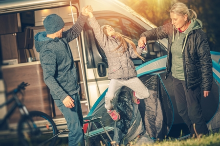 motorcoach: Modern Happy Family Camping. Motorcoach RV Camper Camping. Happy Family with Child.