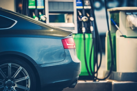 Gas Station Car Refueling. Purchasing Gasoline or Bio Diesel Fuel at the Gas Station.