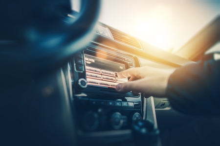 Car Radio Listening. Car Driver Changing Radio Stations on His Vehicle Multimedia System. Modern Touchscreen Audio System. Stok Fotoğraf