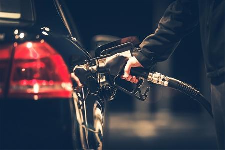 Car Refueling at the Gas Station. Gas Pump Nozzle. Foto de archivo