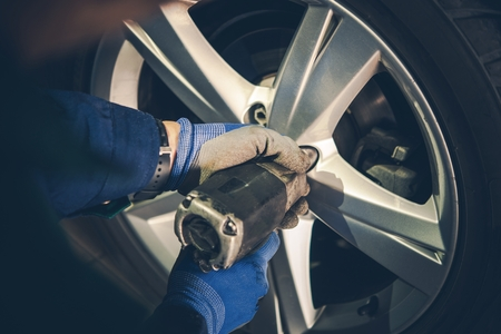 alloy: Winter Tires Replacement and Rotation in the Car Service. Vehicle Seasonal Maintenance.