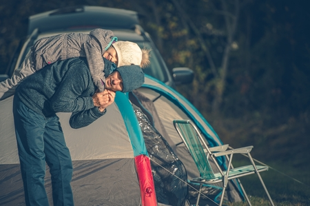 Family Camping Fun. Father with Daughter Having Fun on the Campsite. Stock Photo