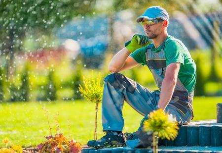 Professional Caucasian Garden Designer in His 30s Taking Break To Rethink New Landscaping Ideas. Gardening Concept.