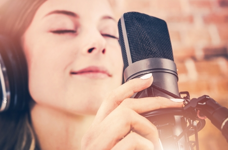 audio book: Music Recording with Passion. Young Music Artist in the Recording Studio. Stock Photo