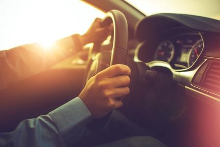 Car and the Driver. Summer Sunset Trip. Modern Car Interior.