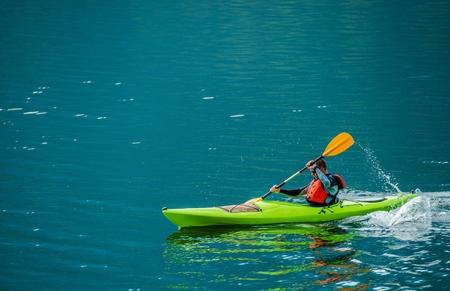 Caucasian Kayaker on the Lake. Kayak Trip on the Scenic Lagoon.