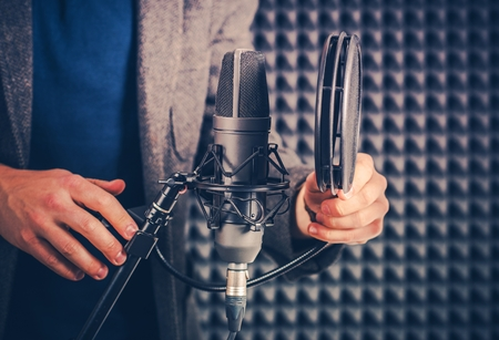 Male Voice Talent in the Studio Preparing Audio Recording Equipment For the Next Recording Session. Stok Fotoğraf
