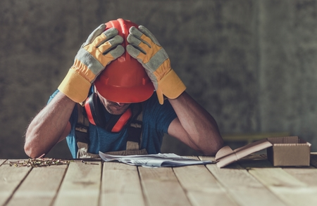 Disappointed Sad Caucasian Contractor Worker Facing Legal Problems. Bond, Insurance, Work Injury Concept Photo. Standard-Bild