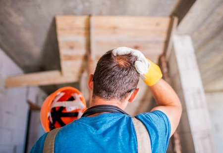 Worker Wearing Hard Hat in the Construction Site. Safety Equipment. Stock Photo