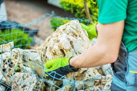 Choosing Rockery Garden Elements. Decorative Stones. Landscaping and Gardening Theme.