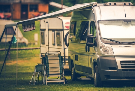 Motorhome Vacation Camping. Camper Van on the Campsite. Stock Photo - 82499143
