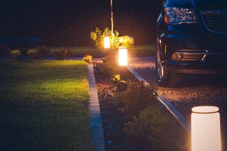 House Driveway Illumination. Elegant Front Yard Illumination. 스톡 콘텐츠