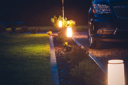 House Driveway Illumination. Elegant Front Yard Illumination. Stockfoto