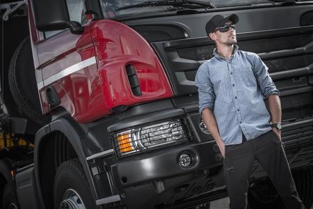 Semi Truck Caucasian Driver. Transportation Industry. Heavy Duty Driver Job.