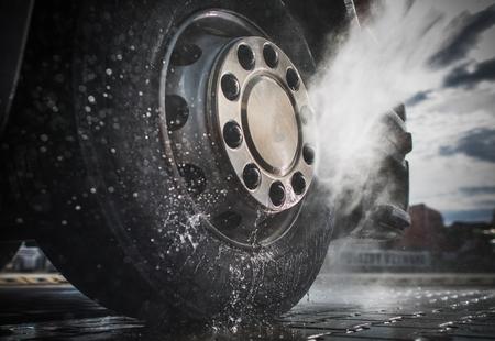 Semi Truck Wheels High Pressured Water Washing Closeup Photo. 스톡 콘텐츠