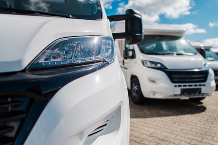 Brand New Camper Vans For Sale on Dealer Lot. Camping and Travel Industry. Stock Photo