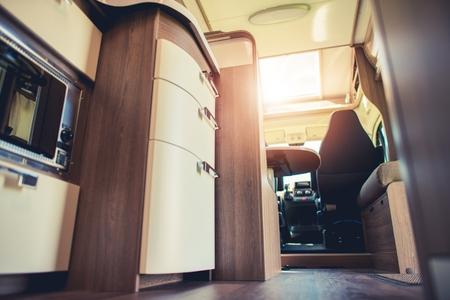 motorcoach: Modern Motorhome Interior. Elegant Materials and Finishing. Motorcoaching Theme.