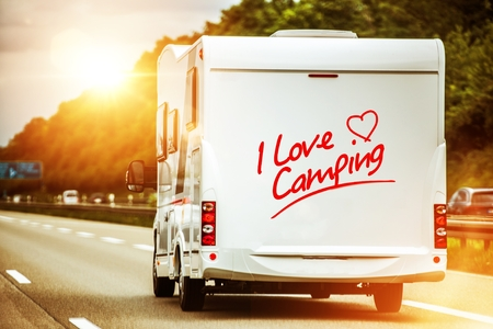 Camping Lover in the Camper Van on the Route to Summer Vacation Destination. Stock Photo