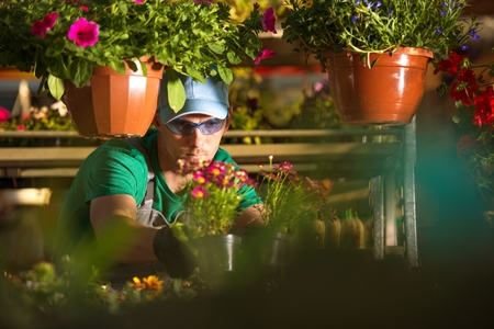Flowers Store Owner. Caucasian Florist and His Garden Business.