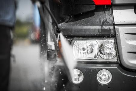 Manual Truck Washing Using High Pressured Hot Water with Detergents. Closeup Photo. Standard-Bild